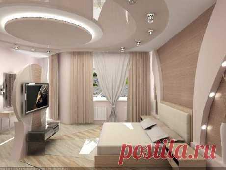 Натяжной потолок в спальне считается наиболее удачным решением для отделки. Узнайте какие современные материалы используются для такого потолка по 50 фото