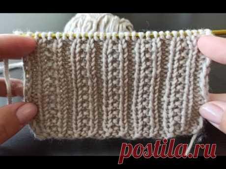 Рельефный узор жемчужная резинка спицами поворотными рядами.