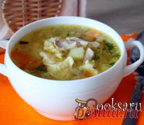 Chicken soup with potatoes and cheese trickled pastries of a photo recipe of preparation