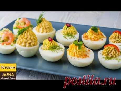5 recetas de los Huevos Rellenados a la mesa de fiesta. Los Huevos de ostentación Rellenados para Nuevo Año