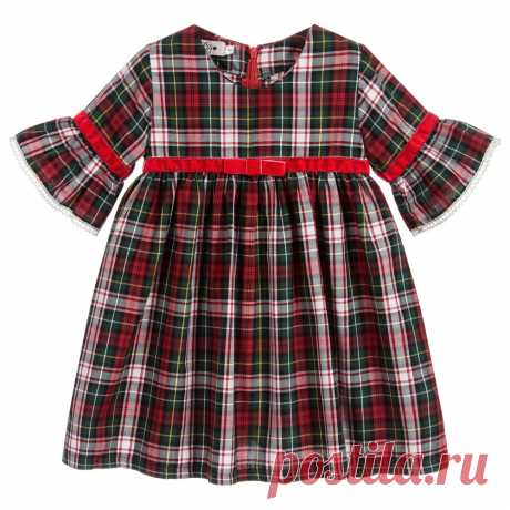 Girls Tartan Cotton Dress Made in soft cotton twill, this charming red and green tartan dress is by Phi Clothing. The elbow length bell sleeves are trimmed with fine ivory lace and red velvet ribbon to match the ribbon detail on the front.