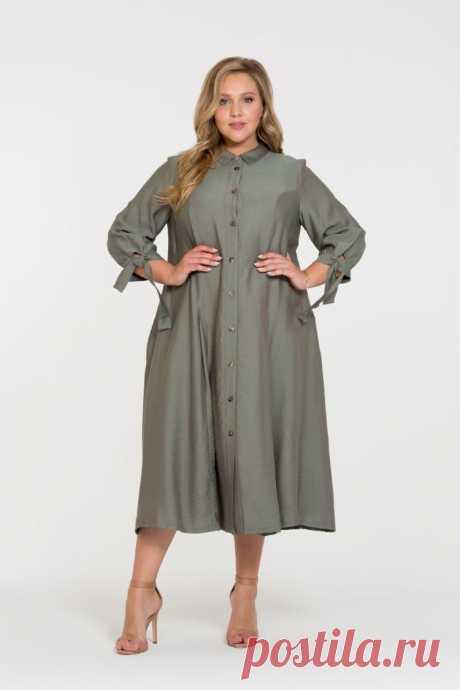 Платье Брилл  для полных женщин купить недорого в России — Интернет-магазин  Платье-рубашка длины миди с рукавом три четверти. Маленький отложной воротник, металлические пуговицы-кнопки. Ширина рукава регулируется широкими завязками. Стильное, удобное и универсальное. Носим с поясом или без, в туфлях на каблуке или кедах - ограничений нет. Подойдет как для офиса, так и для городских прогулок. Носите с кардиганом 7881-310, ветровкой 131635 или пальто Остин.