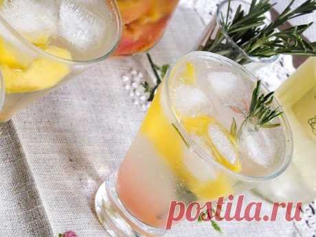 Peach sprittser with rosemary.