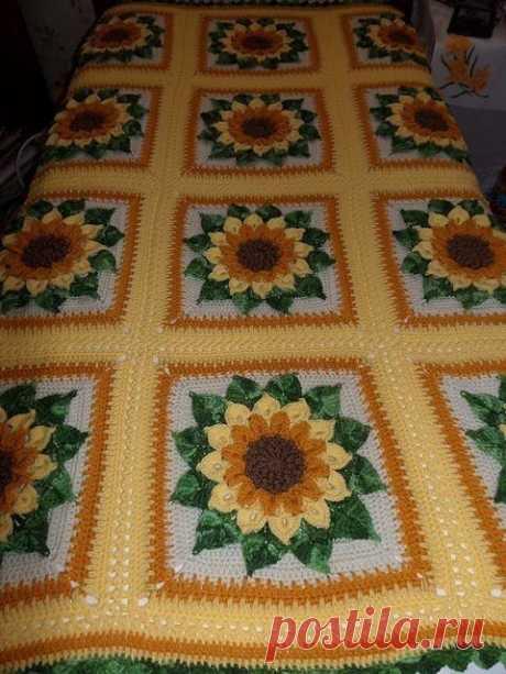 La manta de flores por el gancho