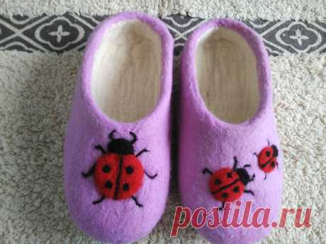 A pair of very soft, original and cheerful handmade shoes.  Such slippers will surely keep your feet warm and cosy. They are safe, made using natural wool.  Hand felted from wool. The soles covered with natural leather (this makes the slippers more safe as they will not slide on the flour).