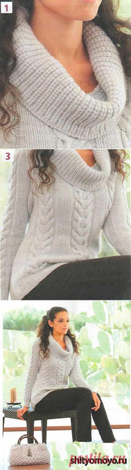 Серый пуловер, связанный спицами.