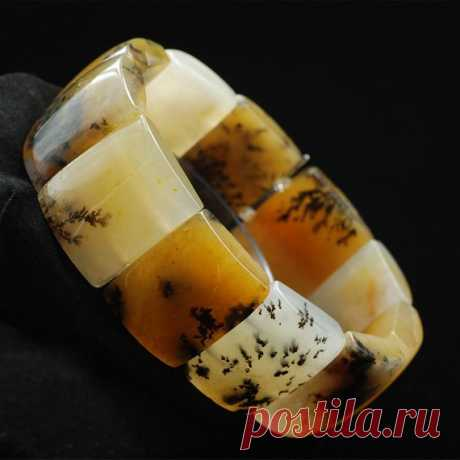 Huanglong jade grass pattern men's wide bracelet / wide bracelet / unique bracelet / elastic bracelet / bracelet cuffs Product Details:  Material: Huanglong jade  Color: picture color  shape: rectangle  Size: single piece width about 20mm, height about 25mm  The inner circumference is about 20cm, and each piece of 11 pieces of jade  Translucent: translucent  Symbol: Good luck to you
