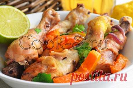 Chicken with pumpkin in an oven