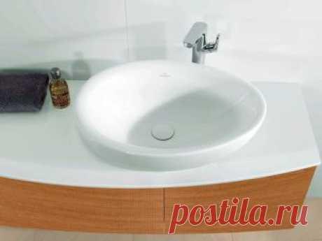 Раковина для ванной накладная на столешницу: виды, выбор, цены Раковина для ванной накладная на столешницу завоевала большую популярность в последнее время. Она отличается простым монтажом, к тому же имеет привлекательный вид. На поверхности тумбы остаётся достаточно места для размещения косметических принадлежностей. Однако перед выбором изделия следует внимательно ознакомиться со всеми достоинствами и недостатками конструкции, а также ассортиментом. Советы дизайнеров пом...