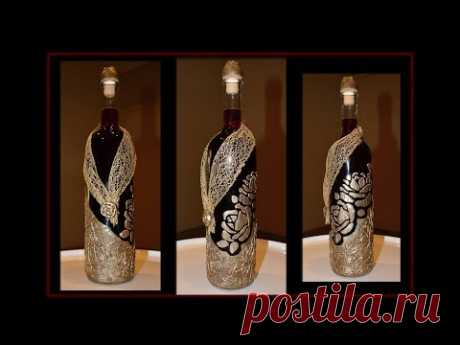 glass bottle decorated with modeling paste and crafts glue (tutorial)