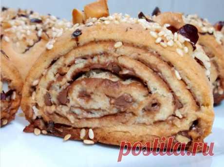 Такого печенья вы еще не ели.Вкуснейшее печенье из песочного теста.Рецепт домашнего печенья Изумительно  вкусное песочное печенье с шоколадной пастой,орехами и сезамом.Рассыпчатое,просто тает во рту.Рецепт песочного теста для печенья очень простой и легкий.ИНГРЕДИЕНТЫ:Мука – 240 грЯйцо -  1 штСливочное масло – 90 грСахар – 50 грМолоко – 1 ст.л.Разрыхлитель -  1 ч.л.Лимонная...