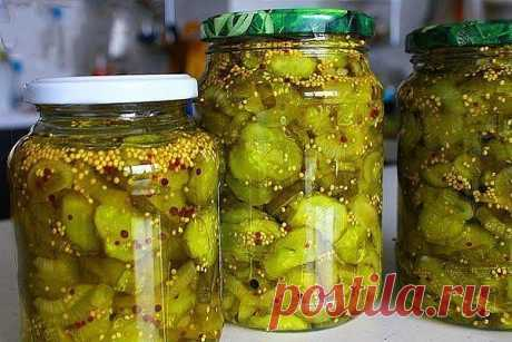 Spicy cucumbers for winter (pickles) \u000d\u000a\u000d\u000aSuch cucumber preparation, brings a spicy note in usual sandwiches, sandwiches or vegetable salads. Big plus is that cucumbers which did not go for salting are good, the option — large cucumbers is just more interesting here. \u000d\u000aStructure: \u000d\u000a\u000d\u000a— 2 kg. fresh large cucumbers \u000d\u000a— 4 large bulbs \u000d\u000a— 6th tablespoons of coarse salt \u000d\u000a— 4 glasses of apple cider vinegar \u000d\u000a— 3 glasses of sugar \u000d\u000a— 4 tablespoons of mustard seeds \u000d\u000a— 1 h spoon of ground turmeric \u000d\u000a— 1 h spoon black pe...