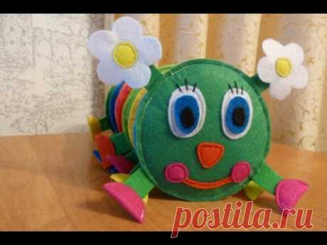 The developing toy from felt. Cheerful caterpillar.