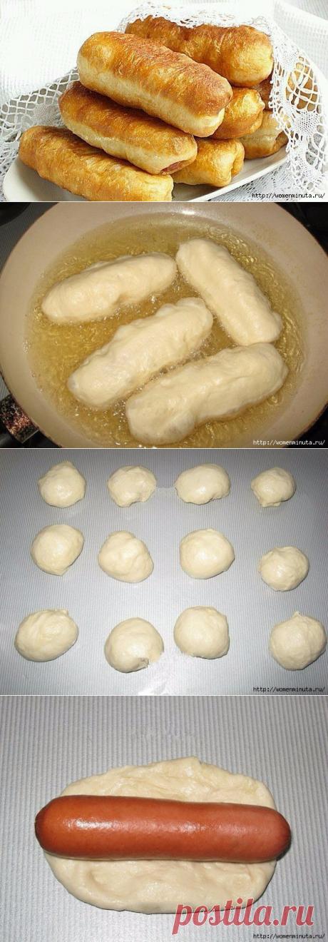 Las salchichas en la masa con levadura - zharennye en la sartén.