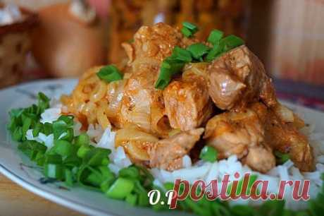 Pork in kefiric sauce on a frying pan