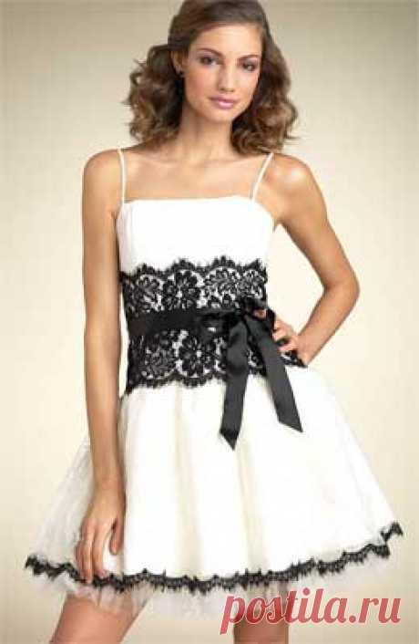 Белое платье на выпускной бал от Анастасии Корфиати Платье на выпускной бал создано для настоящих ангелочков! У платья много изюминок - пышная юбка, невесомый подъюбник, дорогое кружево и бант на талии!
