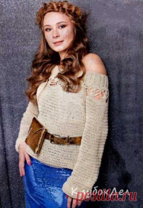 Пуловер крючком «Византия» Соблазнительная ажурная кокетка со спущенным плечом, длинный зауженный рукав и шикарный оттенок пряжи, с золотистыми пайетками. Этот пуловер отвечает всем требованиям современной моды.Размер: XS-SВам потребуется: пряжа Visantia «luxe» (50% полиэстер, 35% вискоза, 15% люрекс, 240 м/ 100 г - 600 г