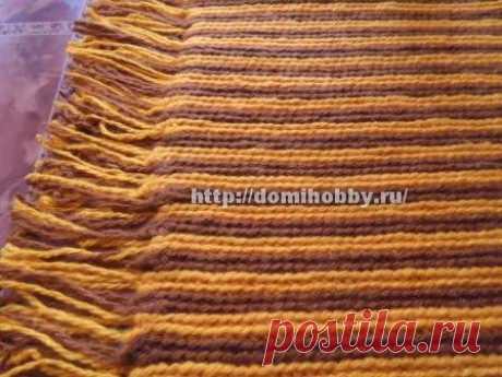 El tapiz pequeño rayado con la franja