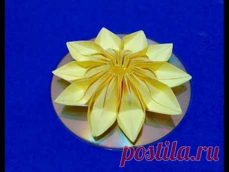 Easy 3d origami flower on CD. DIY origami room decorating ideas.
