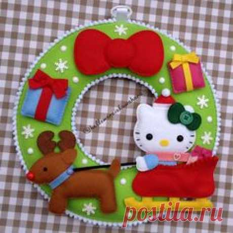 Corona de la kitty navideña