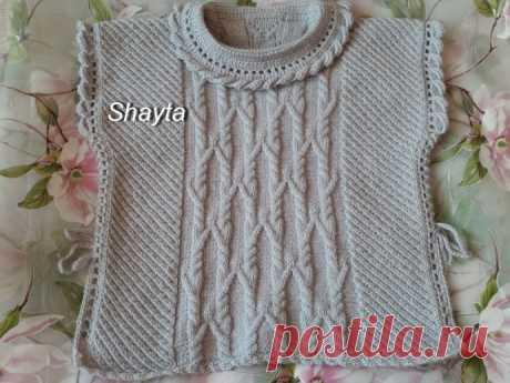 Пончо-пуловер для девочки от Shayta со шнуровкой.