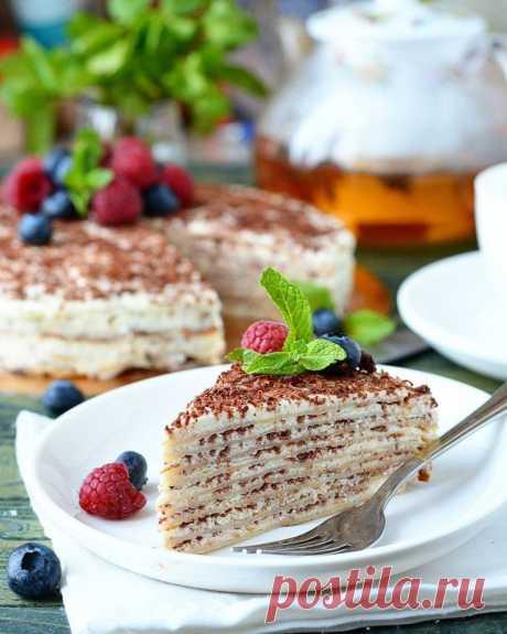 Блинный торт с творожным кремом Ингредиенты: Для блинов: Яйцо куриное — 1 шт. Кефир — 1 стак.Кипяток — 0,5 стак.Мука — 1 стак.Масло растительное — 1 ст. л.Сахар — 2 ст. л.Сода —0,25 ч. л.Соль — 1 щепоткаДля крема: Творог — 400...