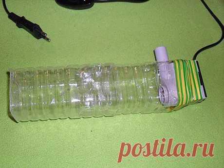 El aspirador-sifón improvisado para el acuario.