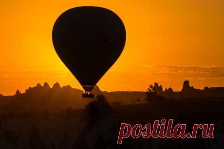 Подъём! Силуэт воздушного шара в утреннем свете солнца из альбома Игоря Иванко: nat-geo.ru/photo/user/287749