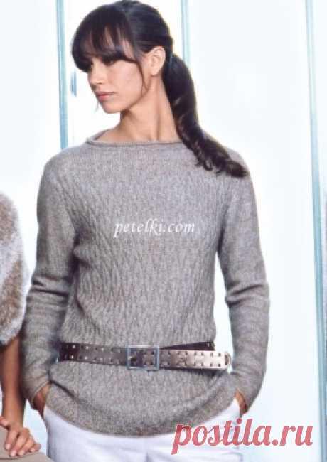 El pulóver alargado de color beige