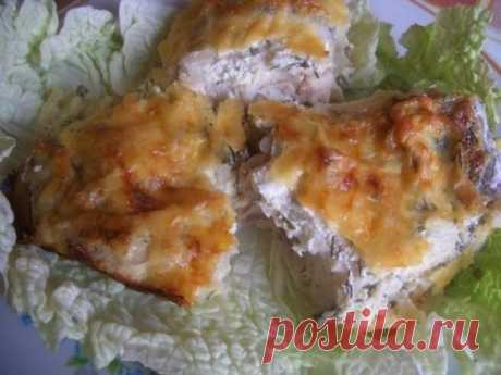 Unusually tasty fish baked in smetanny sauce under a cheese crust!