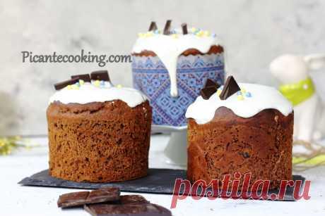 Шоколадна паска з родзинками Дуже ароматна, шоколадна паска з родзинками з пухкого дріжджового тіста. Чудове урізноманітнення традиційної великодньої випічки.