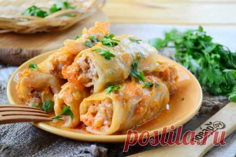 The baked stuffed cabbage in sour cream and ketchup