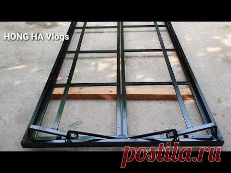 Раздвижные двухстворчатые двери из профтрубы и листового металла