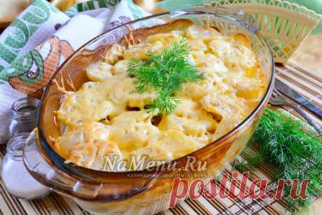 Potatoes baked in an oven with cheese and sour cream