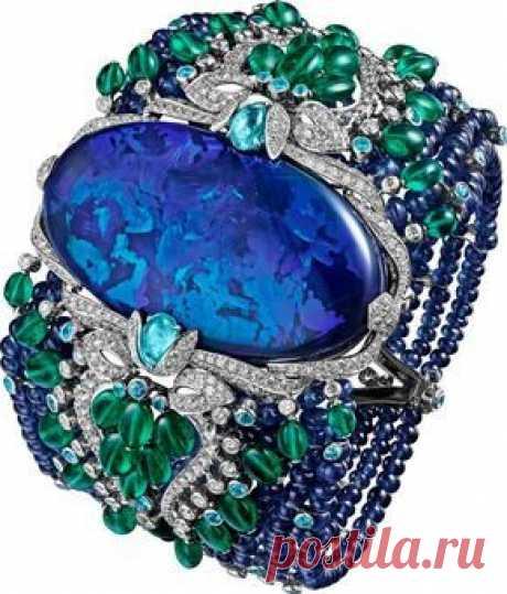 CARTIER BRACELET … Platinum, opal, sapphires, emeralds, Paraiba tourmalines, diamonds.