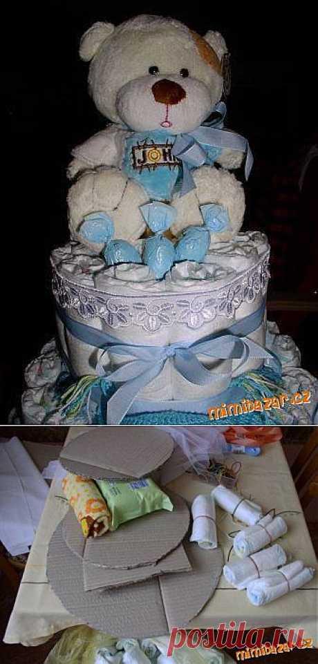 Торт из памперсов с шампанским и игрушкой. Мастер-класс.
