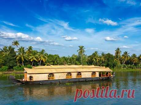 """FLOATING HOUSE. KERALA, INDIA\u000d\u000a\u000d\u000aThe State of Kerala which is in the southern part of India is the real \""""water\"""" area: on 900 km along the coast the whole system of channels, lagoons, the rivers, lakes and gulfs was stretched. As a water transport serve the well-known floating houses here. Their most part is intended for transportation of grain and rice. However especially for tourists some part of floating houses was converted vessels on which it is possible to live and make excursions across Kerala."""