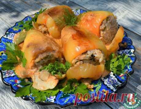 Фаршированные перцы в грибном соусе – кулинарный рецепт