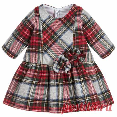Red Wool Tartan Dress A red and grey tartan wool blend dress for little girls by Mebi. This smart dress has an all over tartan pattern and is decorated on the front with matching tartan flowers. The dress is fully lined in soft cotton cloth for comfort and fastens on the back with buttons.