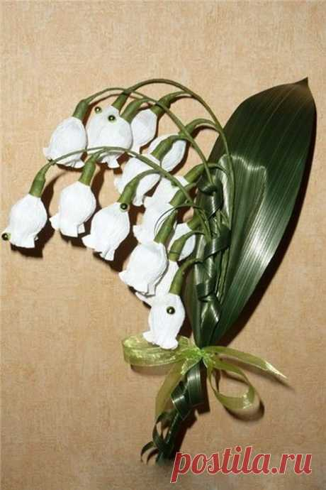 Lilies of the valley with candies.