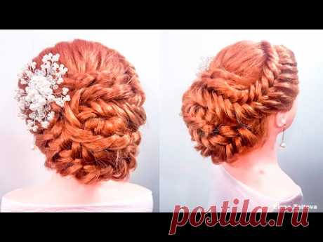 Hairdresses long hair, evening for a graduation party. A hairdress with ornament a cone the hands