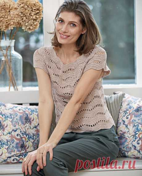 Top with a wavy openwork pattern - the scheme of knitting by a hook.