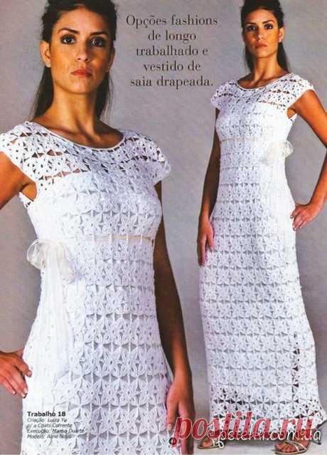 El vestido de boda de los motivos por el gancho. El esquema, el patrón