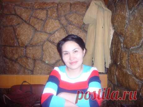 Алма Мамина