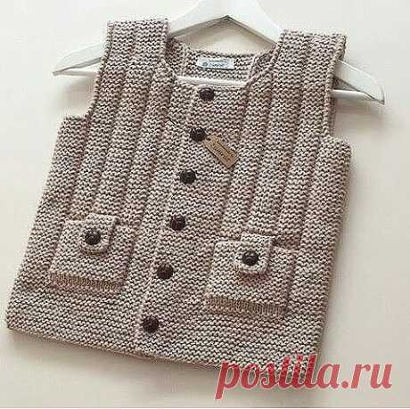 Original children's vest. It is connected by platochny knitting, and a vertical strip a front loop on the person, back on a wrong side.