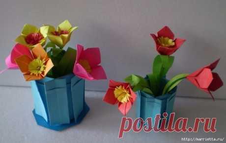 Paper flowers in pots in equipment of origami