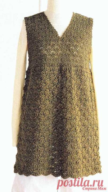 . Туника цвета хаки. Эта симпатичная туника с треугольным вырезом и завышенной линией талии выполнена красивым плотным узором. Пряжа шерсть 350 гр.Крючки 4\0 5\0 6\0. _solo_book crochet_lace 2012