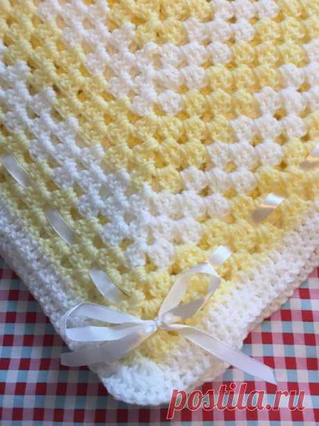 Beautiful pale yellow and white baby blanket Beautiful pale yellow and white baby blanket Made in soft baby wool Would make a lovely baby shower gift Approximately 90cm square