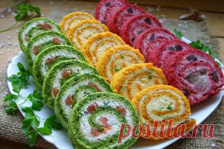 Разноцветные закусочные рулеты Яркая еда всегда привлекает внимание. Так что если хотите удивить гостей, предлагаю сделать оригинальную закуску в виде рулетов трех цветов. И никаких искусственных красителей, все только натуральное. Красный цвет получим благодаря свекле, желтый - из моркови, ну а зеленый - из шпината. С начинкой можно экспериментировать. На самом деле все не так сложно, как может показаться на первый взгляд. На каждый вид рулета вместе с выпечкой уйдет не б...