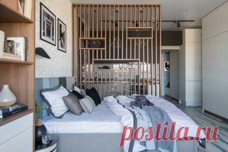 Интерьер квартиры-студии площадью 30 м? с декоративной перегородкой из реек